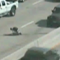 Motorcyclist amazingly survives being nearly crushed between two cars