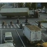 Truck driver flips over 14 wheeler trying to avoid red light