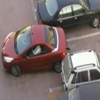 Cars fight for a parking spot
