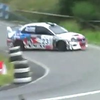 Rallying Mitsubishi EVO slams into parked WRX