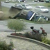 Weird Truck accident caugh on security cam