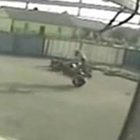 Failed motorcycle stunt caught on surveillance camera