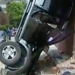 Watch this SUV Fall From a Multistory Parking Garage Garage Directly on the Street