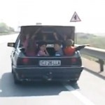 Darwin Awards Nominee: Driver Carrying Kids Around in the Trunk Almost Gets Hit by a Truck