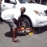 Watch a Man Cut a Denver Boot With a Circular Saw In Front of a Helpless Parking Officer