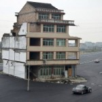 In China, Someone Built A Highway With An Apartment Building Right In The Middle