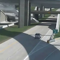 Semi-truck-falls-off-bridge