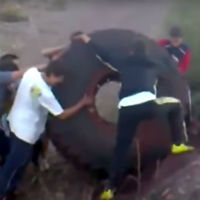 Lets-trow-giant-tire-in-lake